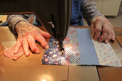 """Stella quilting, she's the """"axis"""" of the Crafting Group at Homestead"""