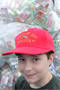 IMG_3740 JPG orion beardsley,11, in front of piles of bags full of bottles and cans