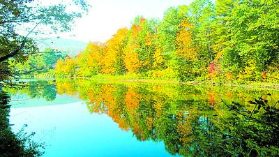 Joe Lauria of Woodstock photo is Ottauquechee River at Taftsville