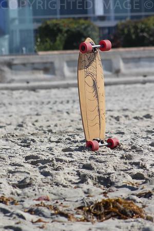 Lonley Skateboard In The Sand