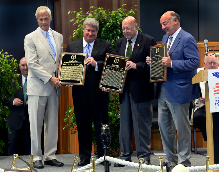 Ashado's owners Paul Saylor, left Johns Martins, center and Jack Wolf, far right receive the Hall of Fame plaque from Ed Bowen at the Thoroughbred Racing Hall of Fame induction ceremony Aug. 8, 2014 in Saratoga Springs, N.Y.   Photo by Skip Dickstein