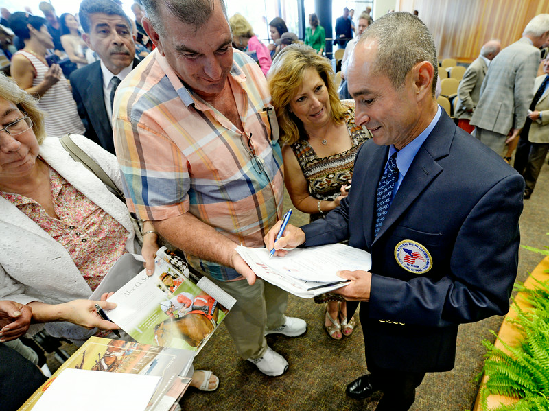 Jockey Alex Solis signs autographs after being inducted in to the Thoroughbred Race Hall of Fame at a ceremony held at the Fasig-Tipton Sales Pavilion Aug. 8, 2014 in Saratoga Springs, N.Y.   Photo by Skip Dickstein