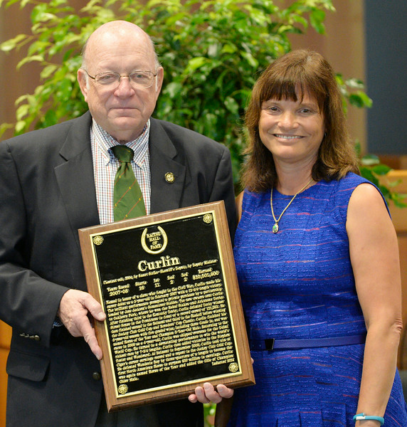 Barbara Banke accepts the plaque from Ed Bowen for Curlin at the Thoroughbred Racing Hall of Fame induction ceremony Aug. 8, 2014 in Saratoga Springs, N.Y.   Photo by Skip Dickstein