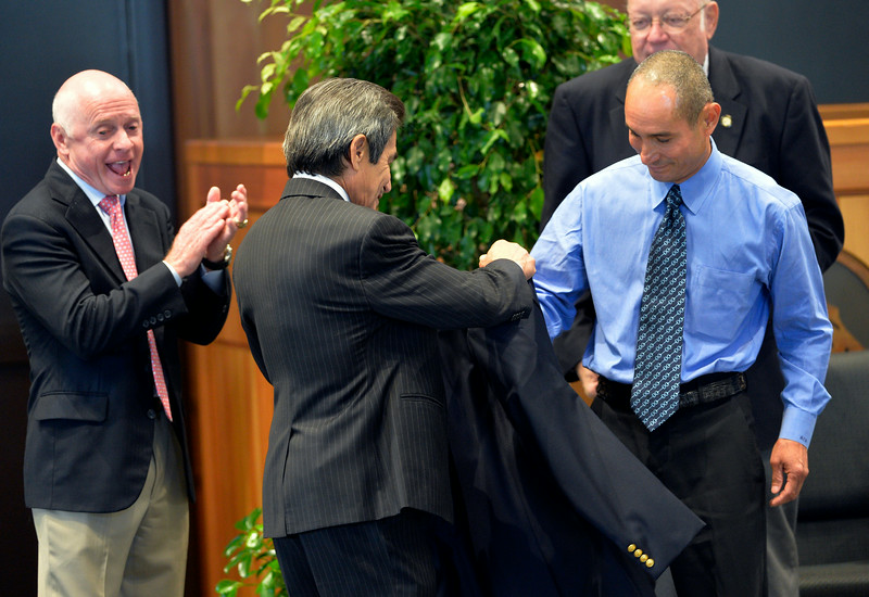 Jockey Alex Solis, right receives his official Hall of Fame jacket from Hall of Fame Jockey Lafitt Pincay Jr. as Hall of fame jockey Chris McCarron shows his joy at the Thoroughbred Racing Hall of Fame induction ceremony Aug. 8, 2014 in Saratoga Springs, N.Y.   Photo by Skip Dickstein