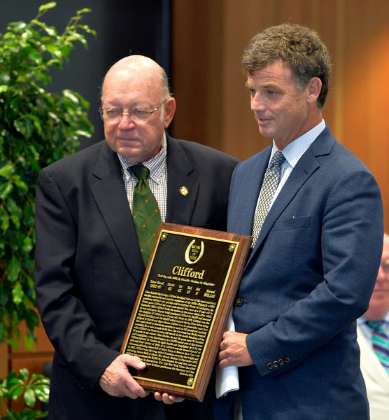Pierre Manigault, great-great-grandson of Clifford owner Stephen Sanford, accepts the plaque from Ed Bowen for Clifford at the Thoroughbred Racing Hall of Fame induction ceremony Aug. 8, 2014 in Saratoga Springs, N.Y.   Photo by Skip Dickstein