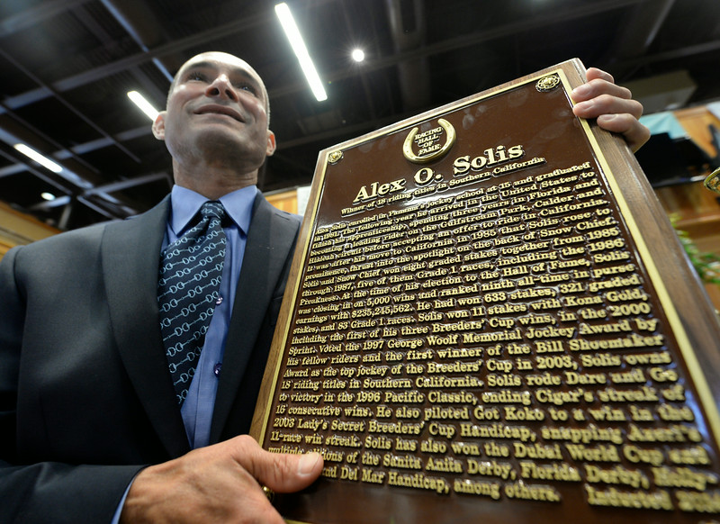 Jockey Alex Solis holds his plaque after being inducted in to the Thoroughbred Race Hall of Fame at a ceremony held at the Fasig-Tipton Sales Pavilion Aug. 8, 2014 in Saratoga Springs, N.Y.   Photo by Skip Dickstein