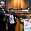 NYRA, senior vice president helps jockey Victor Espinoza with his honorary jacket at the National Museum of Racing and Hall of Fame induction ceremony held Aug. 4, 2017 at the Fasig Tipton auditorium in Saratoga Springs, N.Y. <br /> Photo by Skip Dickstein