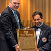 NYRA senior vice president Martin Panza helps jockey Victor Espinoza with his Hall of Fame Plaque at the National Museum of Racing and Hall of Fame induction ceremony held Aug. 4, 2017 at the Fasig Tipton auditorium in Saratoga Springs, N.Y. <br /> Photo by Skip Dickstein
