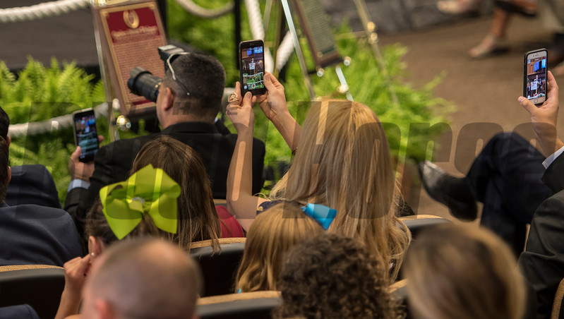 Cell phone users record the event at the National Museum of Racing and Hall of Fame induction ceremony held Aug. 4, 2017 at the Fasig Tipton auditorium in Saratoga Springs, N.Y. <br /> Photo by Skip Dickstein