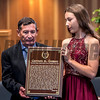 Louie Gomez, father of the late jockey Garrett Gomez holds the Hall of Fame Plaque with his grand daughter Amanda Gomez at the National Museum of Racing and Hall of Fame induction ceremony held Aug. 4, 2017 at the Fasig Tipton auditorium in Saratoga Springs, N.Y. <br /> Photo by Skip Dickstein
