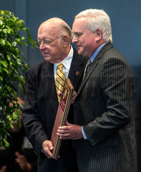 Thomas Gaines, soon John R. Gaines accepts the plaque for his father presented by Edward Bowen at the National Museum of Racing and Hall of Fame induction ceremony held Aug. 4, 2017 at the Fasig Tipton auditorium in Saratoga Springs, N.Y. <br /> Photo by Skip Dickstein