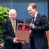 Ogden Phipps II accepts the plaque for his father Dinny Phipps presented by Edward Bowen, left,  at the National Museum of Racing and Hall of Fame induction ceremony held Aug. 4, 2017 at the Fasig Tipton auditorium in Saratoga Springs, N.Y. <br /> Photo by Skip Dickstein