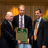 Edward Bowen presents the Hall of Fame Plaque to Sam Voss, son of Tom Voss with Joe Clancy at the National Museum of Racing and Hall of Fame induction ceremony held Aug. 4, 2017 at the Fasig Tipton auditorium in Saratoga Springs, N.Y. <br /> Photo by Skip Dickstein