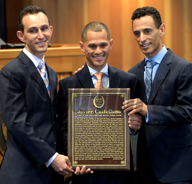 Class of 2017 HOF member jockey Javier Castellano holds his HOF plaque with an assist from fellow HOF members Ramon Dominguez, left and John Velazquez, right,at the National Museum of Racing and Hall of Fame induction ceremony held Aug. 4, 2017 at the Fasig Tipton auditorium in Saratoga Springs, N.Y. <br /> Photo by Skip Dickstein