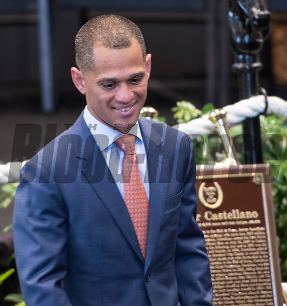Jockey Javier Castellano walks past his bronze Hall of Fame plaque at the National Museum of Racing and Hall of Fame induction ceremony held Aug. 4, 2017 at the Fasig Tipton auditorium in Saratoga Springs, N.Y. <br /> Photo by Skip Dickstein