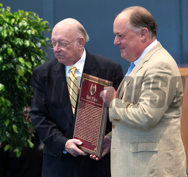 Richard Herrmann, great-grandson of Matt Winn receives the Hall of Fame plaque from Edward Bowen at the National Museum of Racing and Hall of Fame induction ceremony held Aug. 4, 2017 at the Fasig Tipton auditorium in Saratoga Springs, N.Y. <br /> Photo by Skip Dickstein