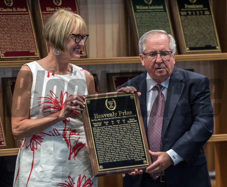 Trainer Shug McGuaghey accepts the plaque for Heavenly Prize from museum director Cathy Marino in the contemporary horse category at the induction ceremony held at the Finney Pavilion of the Fasig-Tipton Sales Company Friday Aug. 3, 2018 in Saratoga Springs, N.Y.  Photo by Skip Dickstein