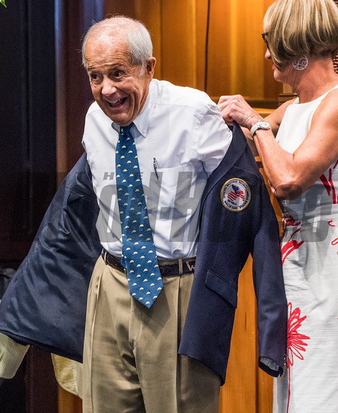 Cot Campbell is all smiles as she accepts his Hall of Fame jacket from director Cathy Marino as a new Pillar of the Turf at the induction ceremony held at the Finney Pavilion of the Fasig-Tipton Sales Company Friday Aug. 3, 2018 in Saratoga Springs, N.Y.  Photo by Skip Dickstein