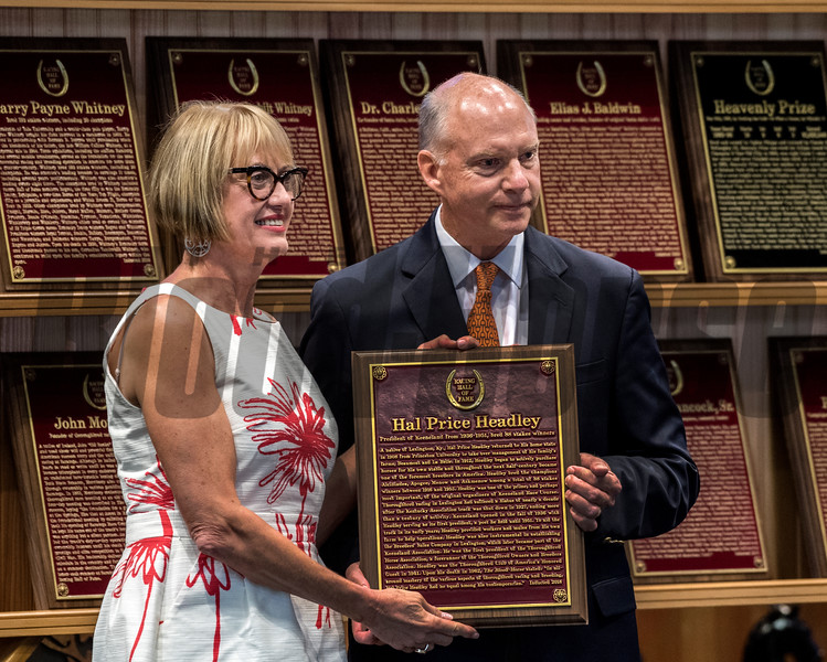 Headley Bell, grandson accepts the Pillars of the Turf plaque for his grandfather Hal Price Headley from director Cathy Marino at the induction ceremony held at the Finney Pavilion of the Fasig-Tipton Sales Company Friday Aug. 3, 2018 in Saratoga Springs, N.Y.  Photo by Skip Dickstein