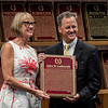 John Phillips, grandson of John W. Galbraith accepts the plaque for his late grandfather John W. Galbraith from director Cathy Marino at the induction ceremony held at the Finney Pavilion of the Fasig-Tipton Sales Company Friday Aug. 3, 2018 in Saratoga Springs, N.Y.  Photo by Skip Dickstein