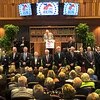 Members of the National Museum of Racing and Hall of Fame line up at the beginning of the induction ceremony held at the Finney Pavilion of the Fasig-Tipton Sales Company Friday Aug. 3, 2018 in Saratoga Springs, N.Y.  Photo by Skip Dickstein