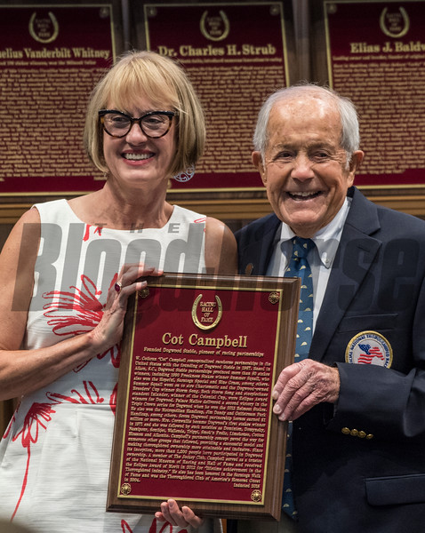 Cot Campbell is all smiles as she accepts his induction plaque in the Hall of Fame as a Pillar of the Turf from director Cathy Marino at the induction ceremony held at the Finney Pavilion of the Fasig-Tipton Sales Company Friday Aug. 3, 2018 in Saratoga Springs, N.Y.  Photo by Skip Dickstein