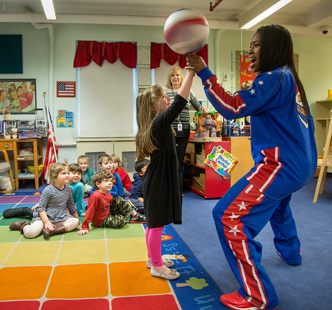 """Harlem Globetrotter """"TNT"""" showed of her basketball tricks as she visited children in the pediatrics department at Holy Name Medical Center. Photo by Jeff Rhode"""
