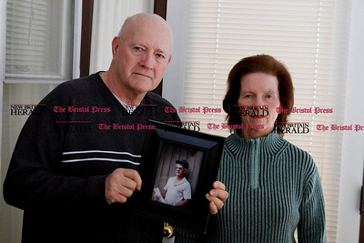 Kevin Bartram   Staff Norman LaFontaine and his sister Terry Dubuc are shown with a photograph of their brother, Pete LaFontaine, at Norman's home in New Britain on Tuesday. Pete LaFontaine was murdered and the case has not been resolved.