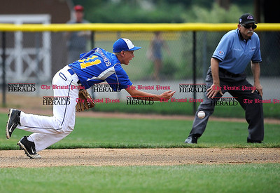 8/1/2014 Mike Orazzi | Staff Maine's Michael Simonds (11) fields a ground ball against New Hampshire at Breen Field in Bristol on Friday.