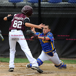 8/1/2014 Mike Orazzi | Staff Maine's's Francis Kiely (99) tags out New Hampshire Bobby Doherty at home plate during a 3-1 Maine win at Breen Field in Bristol on Friday.