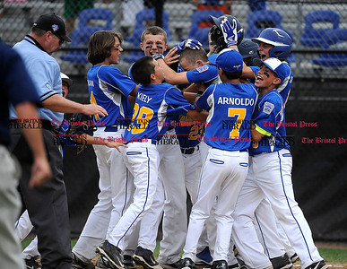 8/1/2014 Mike Orazzi | Staff Maine players surround Alexander Smith (26) after his two run game winning home run in the bottom of the 6th inning to defeat New Hampshire 3-1 at Breen Field in Bristol on Friday.