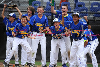 8/1/2014 Mike Orazzi | Staff Maine players wait for Alexander Smith (26) after his two run game winning home run in the bottom of the 6th inning to defeat New Hampshire 3-1 at Breen Field in Bristol on Friday.