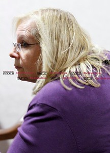 Kevin Bartram | Staff Suzanne Bielinski leaves a New Britain Civil Service Commission meeting Monday evening after the commission decided to delay any decision until a future meeting.