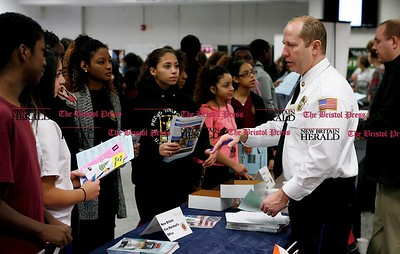 Kevin Bartram | Staff Don King of the New Britan Fire Marshall's office talks to students during the New Britain High School Academy of Finance and Health Academy Career Fair on Tuesday at the school.