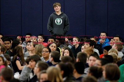 Kevin Bartram | Staff Eighth grader Connor Feeney-Wallace stands to show the importance of one act of kindness during the second annual Acts of Kindness Month assembly at Greene-Hills School in Bristol on Monday. Sharon Campolo, a teacher at the school, started the event in honor of Sandy Hook Elementary School.