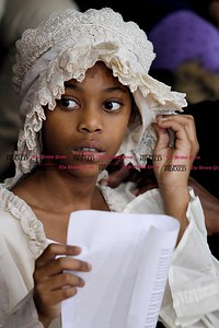 Kevin Bartram | Staff Difatullah Brown studies her lines as she prepares to portray Katherine during a Colonial Town Hall event at the House of Arts Letters and Science Academy in New Britain on Tuesday.