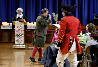 Kevin Bartram | Staff Gad Stanley, portrayed by Luke Boyd speaks during a Colonial Town Hall event at the House of Arts Letters and Science Academy in New Britain on Tuesday.