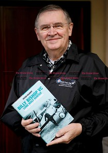 "Kevin Bartram | Staff New Britain author Peter Kilduff holds his latest book, ""Billy Biship VC: The Line Wolf Hunter."""