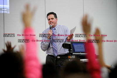 Kevin Bartram | Staff Principal Scott Gaudet speaks during the second annual Acts of Kindness Month assembly at Greene-Hills School in Bristol on Monday. Sharon Campolo, a teacher at the school, started the event in honor of Sandy Hook Elementary School.