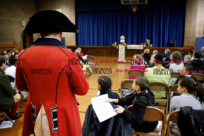 Kevin Bartram | Staff Chris Oriole watches over a Colonial Town Hall event at the House of Arts Letters and Science Academy in New Britain on Tuesday.