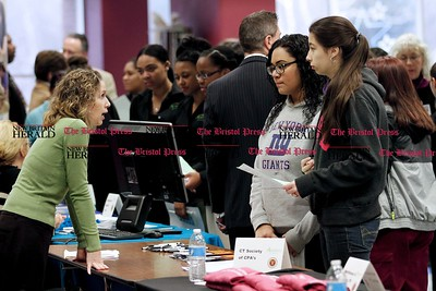 Kevin Bartram | Staff Jill Brighten, left, of the Connecticut Society of CPAs talks to Kiara Diaz, center, and Niera Husic during the New Britain High School Academy of Finance and Health Academy Career Fair on Tuesday at the school.