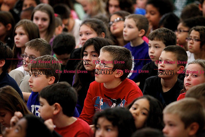Kevin Bartram | Staff Fourth grader Konrad Truszkowski is surrounded by hundreds of classmates during the second annual Acts of Kindness Month assembly at Greene-Hills School in Bristol on Monday. Sharon Campolo, a teacher at the school, started the event in honor of Sandy Hook Elementary School.