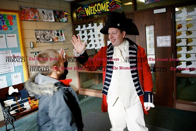Kevin Bartram | Staff Chris Oriole welcomes students to a Colonial Town Hall event at the House of Arts Letters and Science Academy in New Britain on Tuesday.