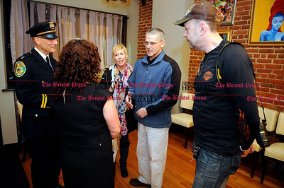 2/1/2014 Mike Orazzi | Staff Kim and Mike Morgan talk with New Britain Chief of Police James Wardwell and Belvedere Café and Restaurant owners Elizabeth and Matt Konferowicz during a fund raiser for their son Brett  on Saturday night.