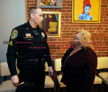 2/1/2014 Mike Orazzi | Staff New Britain police officer John Blackmore talks with Yvonne Krosky at the Belvedere Café and Restaurant during a fund raiser for police officer Brett  Morgan on Saturday night.