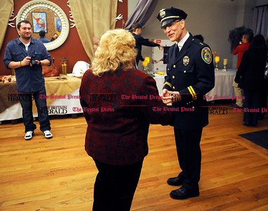 2/1/2014 Mike Orazzi | Staff New Britain Chief of Police James Wardwell talks with Yvonne Krosky at the Belvedere Café and Restaurant during a fund raiser for police officer Brett  Morgan on Saturday night.