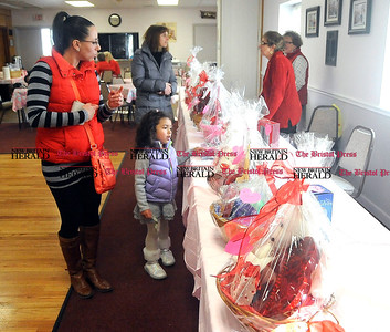 2/1/2014 Mike Orazzi | Staff  Zulma Arroyo and her four-year-old daughter Angelica look over baskets of chocolate during the 11th Annual Valentine Chocolate Festival held at the Southington American Legion Saturday.