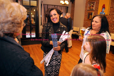 2/1/2014 Mike Orazzi | Staff New Britain police officer Emily Banos while selling raffle tickets during a fund raiser for police officer Brett  Morgan on Saturday night at the Belvedere Café and Restaurant.