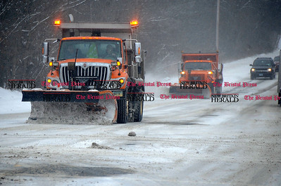 1/2/2014 Mike Orazzi | Staff State plows out during Winter Storm Hercules on Thursday morning.