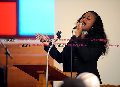 1/1/2014 Mike Orazzi | Staff Leading Lady Linda sings a solo during the NAACP New Britain Branch's Emancipation Day Program held at the Second Baptist Church on Chapman Street on Wednesday morning.